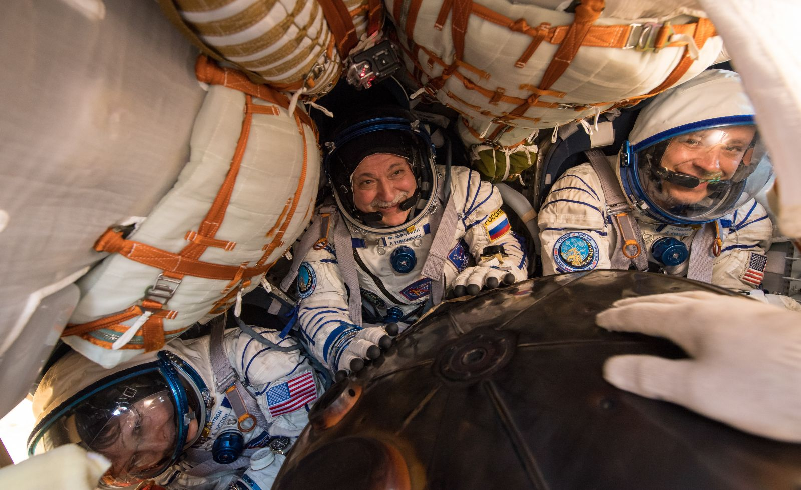 Expedition 52 Flight Engineer Peggy Whitson, left, Commander Fyodor Yurchikhin of Roscosmos, center, and Flight Engineer Jack Fischer get their first taste of fresh air in months. Whitson was in space for 288 days while Yurchikhin and Fischer were in orbit for 136 days. Photo Credit: Bill Ingalls / NASA