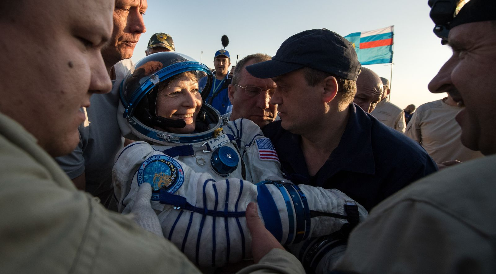 Peggy Whitson was the final crew member of Soyuz MS-04 to be helped out. All three were placed on lawn chair-like couches for an initial health check before being transported to a nearby medical tent for further evaluation. Photo Credit: Bill Ingalls / NASA