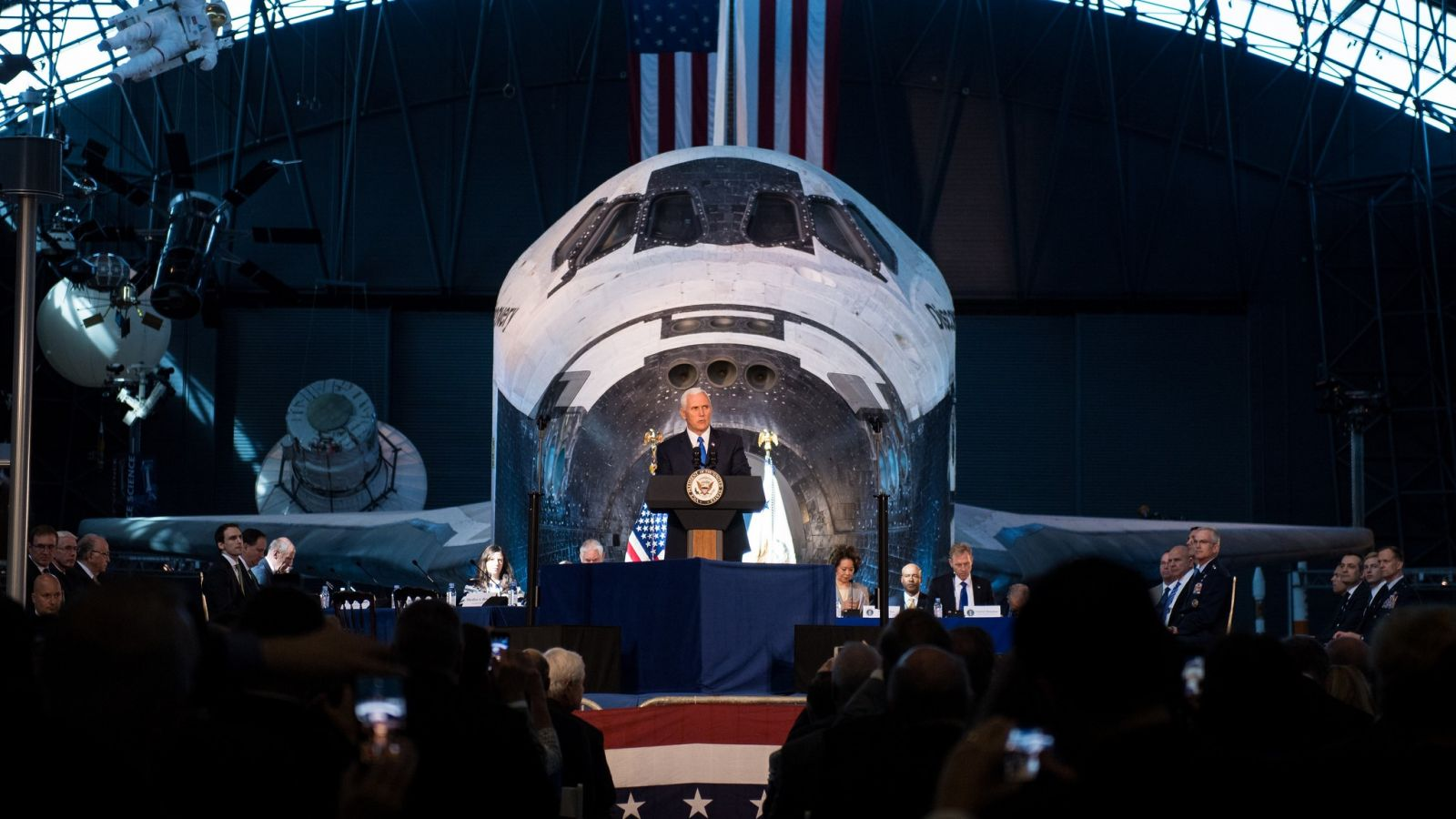 Vice President Pence deliveres opening remarks during the National Space Council's first meeting Oct. 5, 2017, in front of Space Shuttle Discovery at the National Air and Space Museum's Udvar-Hazy Center in Chantilly, Virginia. Photo Credit: Joel Kowsky / NASA