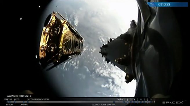 The ninth of 10 Iridium NEXT satellites on the Iridium-3 mission is deployed about 1 hour, 10 minutes after launch. Some of the satellites already deployed can be seen in the upper left side of the picture. Photo Credit: SpaceX webcast