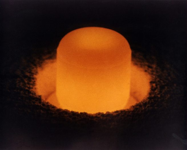 A Plutonium-238 oxide pellet glowing from its own heat