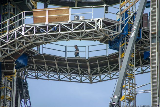 A worker walks across the mass climber segment of Test Stand 4693. Photo Credit: Vikash Mahadeo / SpaceFlight Insider