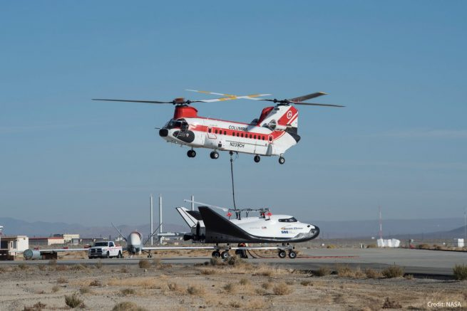 A twin-rotor helicopter was used to lift the Dream Chaser test article off the ground for the free-flight test. Photo Credit: NASA