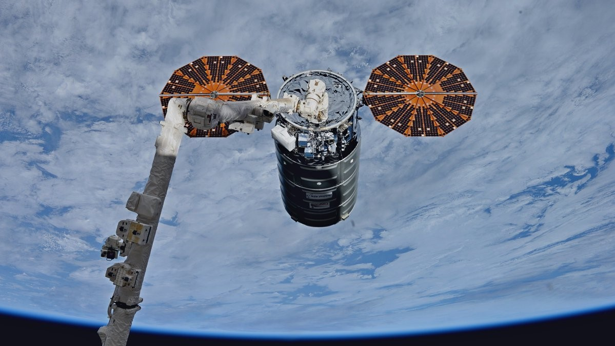 The OA-8 Cygnus, named S.S. Gene Cernan, is captured by the International Space Station's robotic Canadarm2. Photo Credit: NASA
