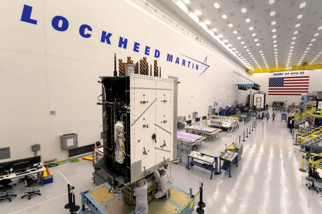 A file photo of a GPS III satellite being integrated in a cleanroom. The U.S. Global Positioning System satellite constellation is operated by the Air Force Space Command. Photo Credit: Lockheed Martin