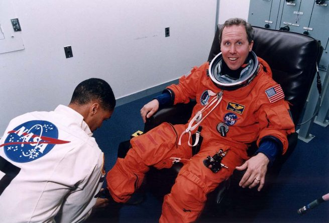 Mission Specialist 2, Tom Jones, gets suited up for Columbia's flight on Nov. 19, 1996. Photo Credit: NASA