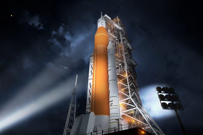 An artist's impression of an SLS Block 1 rocket on the launch pad at night. Image Credit: NASA
