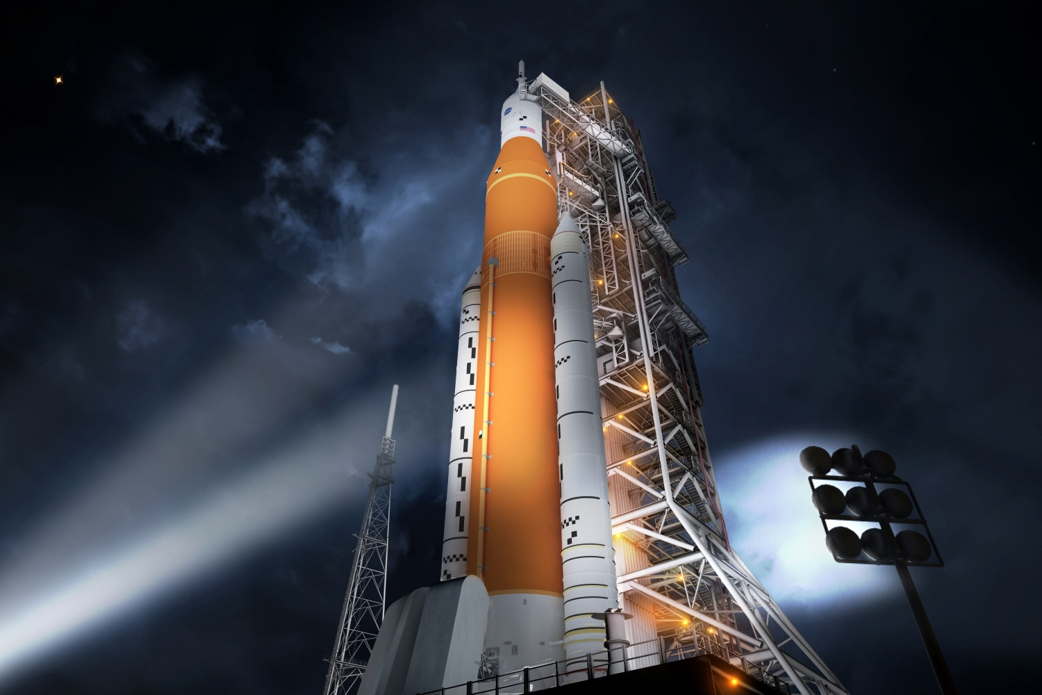 SLS Block-1 on launchpad at night