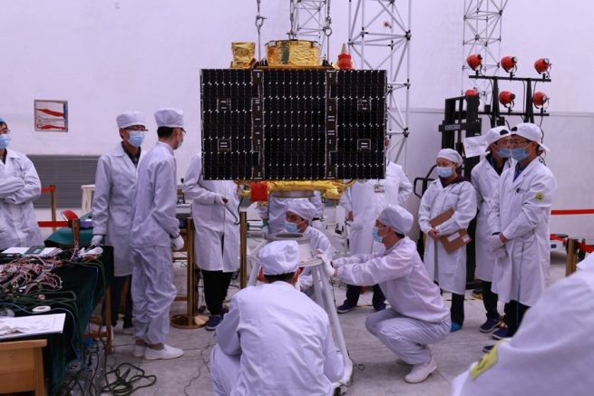 Researchers work on one of Jilin-1 satellites.