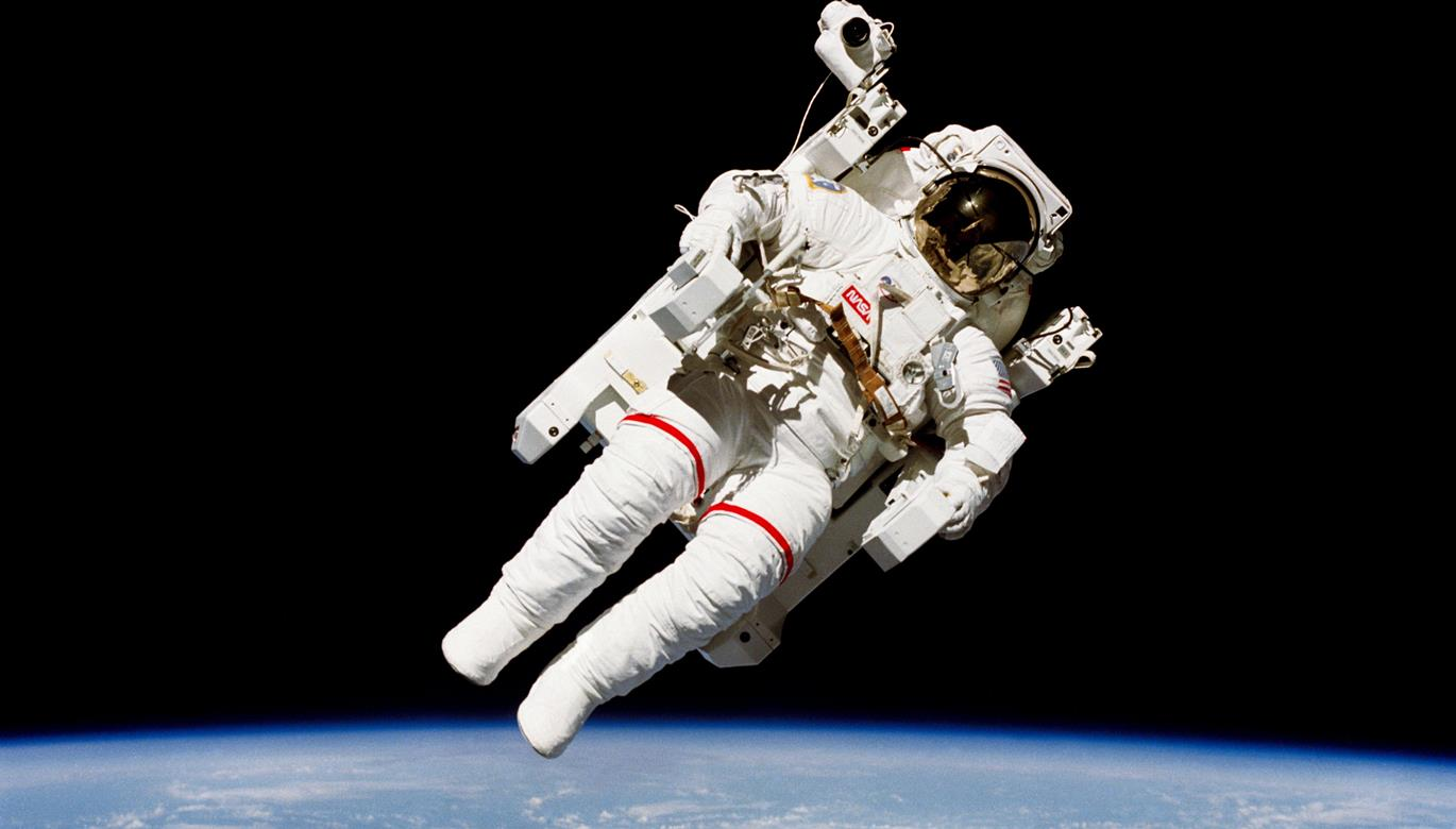 Untethered humanity 39 s first free flying astronaut bruce for Flying spaces