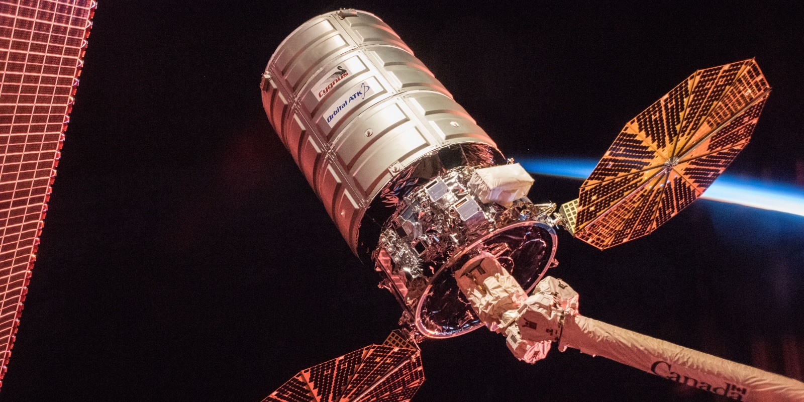 Cygnus OA-8 cargo spacecraft at sunrise