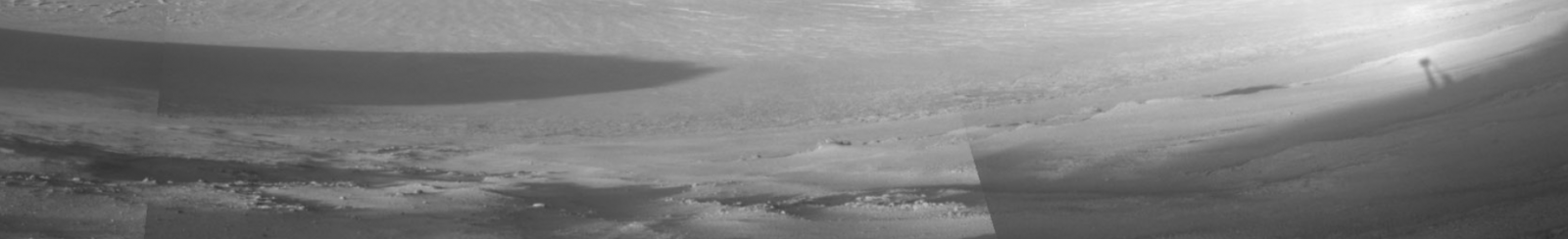 The shadow from Opportunity can be seen in the upper-right corner of the image as the late-afternoon sun casts shadows across Endurance Crater.