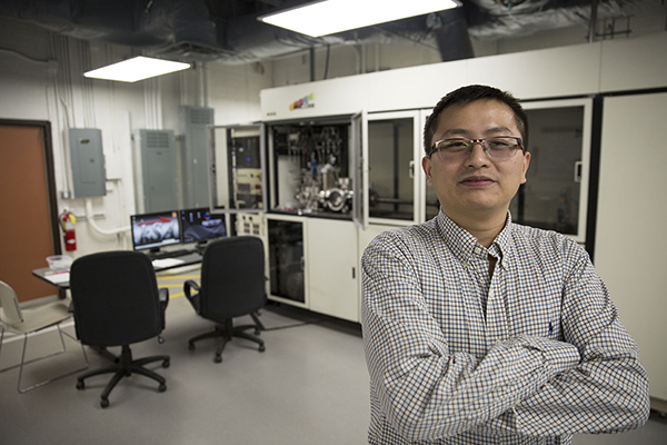 Yuji Zhao stands in his Metal-Organic Chemical Vapor Deposition lab on the Tempe campus, where he works with gallium nitride.