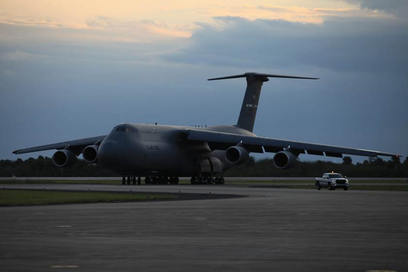 A USAF C-5M aircraft arrives at the Shuttle Landing Facility at NASA's Kennedy Space Center in Florida, with the Geostationary Operation Environmental Satellite-S (GOES-S). Photo Credit: Leif Heimbold / NASA