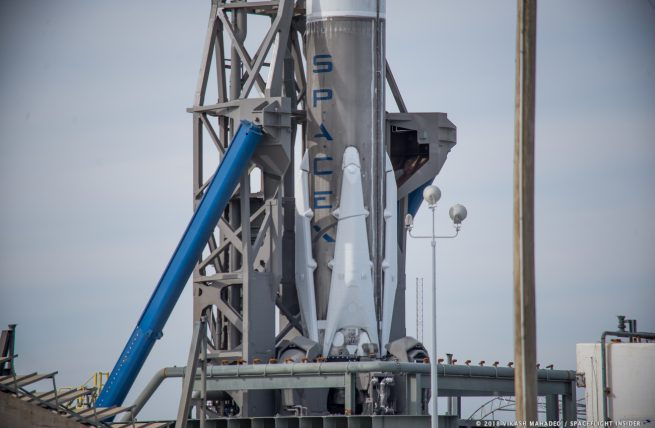 Although this Falcon 9 sported landing legs and grid fins, it was not listed as attempting a landing either on an ASDS or at Canaveral's Landing Zone-1. Photo Credit: Vikash Mahadeo / SpaceFlight Insider