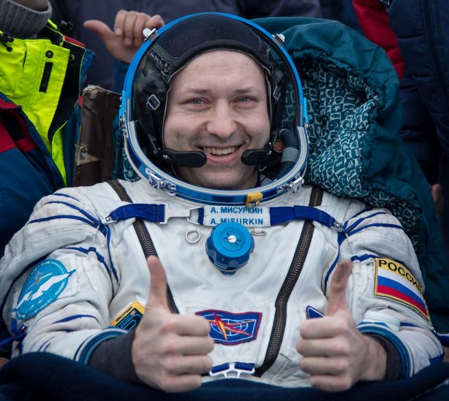 "Alexander Misurkin gives a ""thumbs up"" after concluding his flight into space. Photo Credit: Bill Ingalls / NASA"