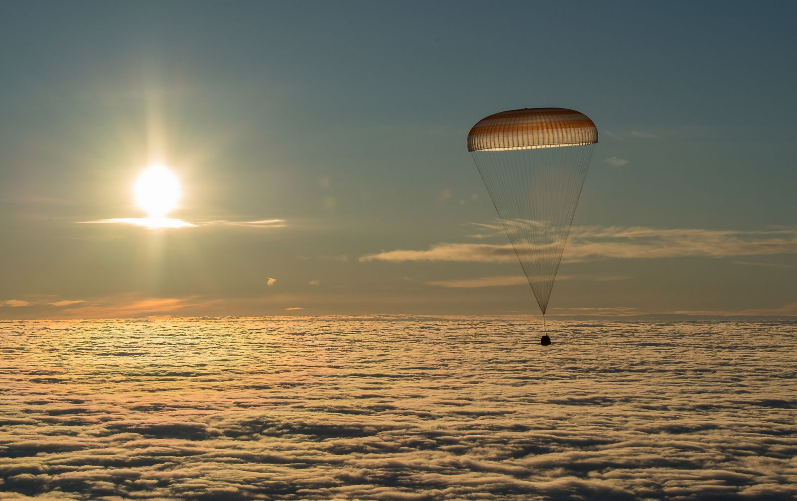 Soyuz MS-06 descends with Expedition 54 crew members Alexander Misurkin of Roscosmos and Joe Acaba and Mark Vande Hei of NASA. Photo Credit: Bill Ingalls / NASA