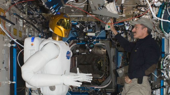 Expedition 30 commander Dan Burbank checks out Robonaut2 in February 2012. The android will be returning to Earth at the conclusion of the CRS-14 mission. Photo Credit: NASA