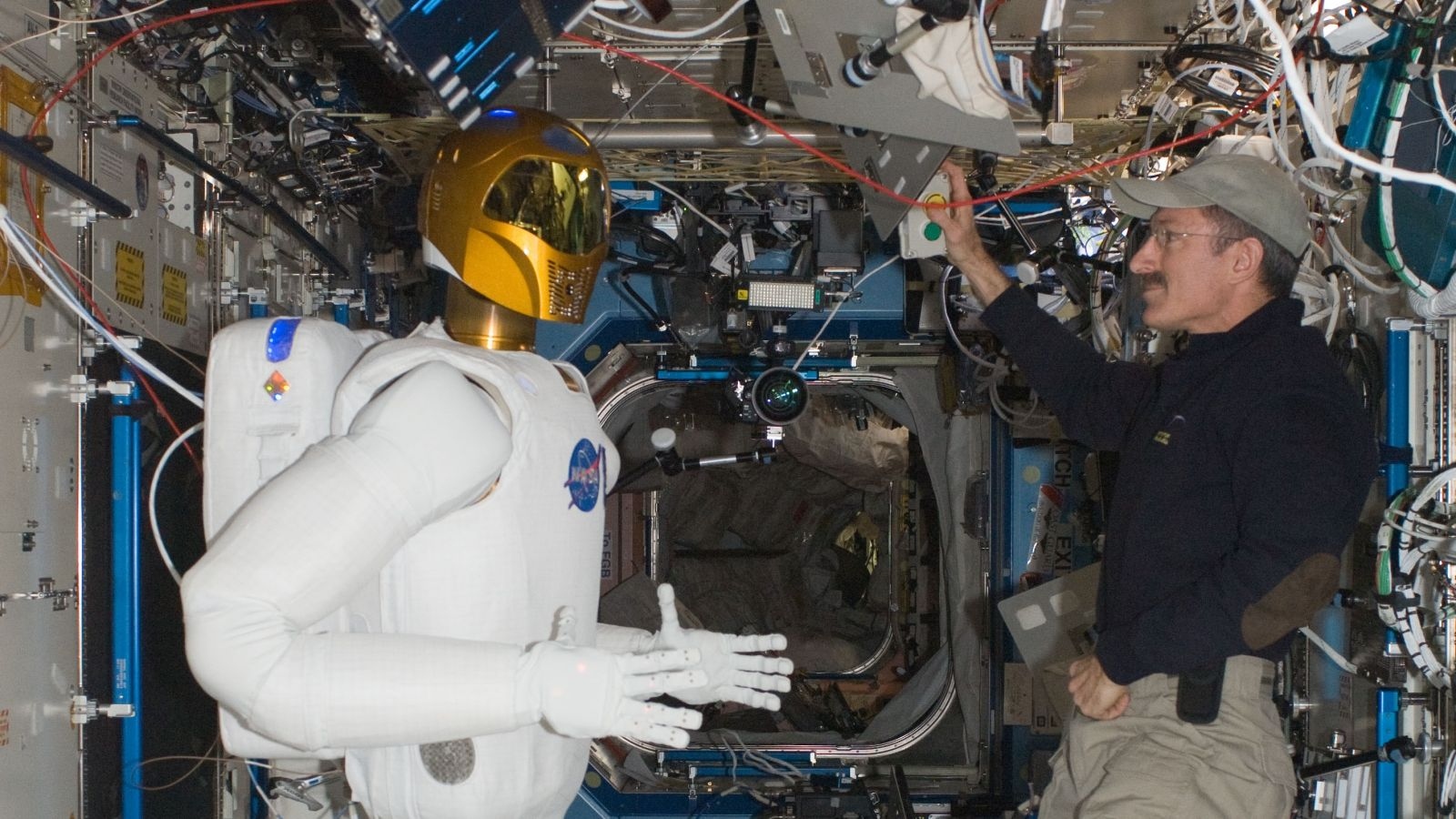 Expedition 30 commander Dan Burbank checks out Robonaut2 in February 2012. Photo Credit: NASA