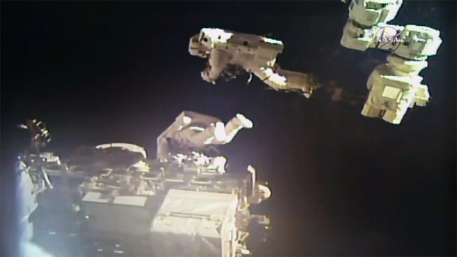 NASA astronaut Mark Vande Hei, upper right, and Japanese astronaut Norishige Kanai tag-teamed to reshuffle the locations of the old latching end effectors. Photo Credit: NASA