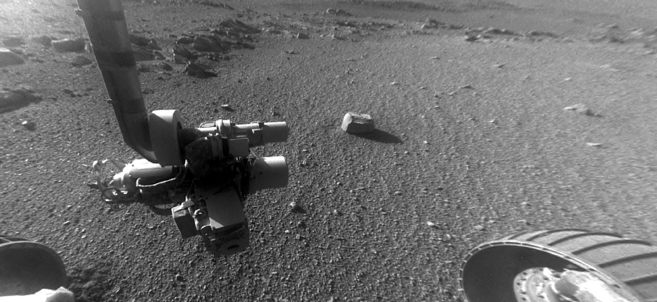 This late-afternoon view from the front Hazard Avoidance Camera on NASA's Mars Exploration Rover Opportunity shows a pattern of rock stripes on the ground, a surprise to scientists on the rover team. It was taken in January 2018, as the rover neared Sol 5000 of what was planned as a 90-sol mission. Image Credit: NASA/JPL-Caltech