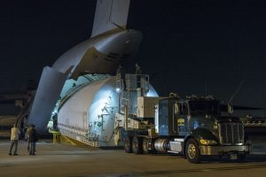 The Space Telescope Transporter for Air, Road and Sea (STTARS), carrying the optical telescope and integrated science instrument module (OTIS) arrives at LAX aboard a C-5C Galaxy on February 2, 2018. Photo Credit: NASA