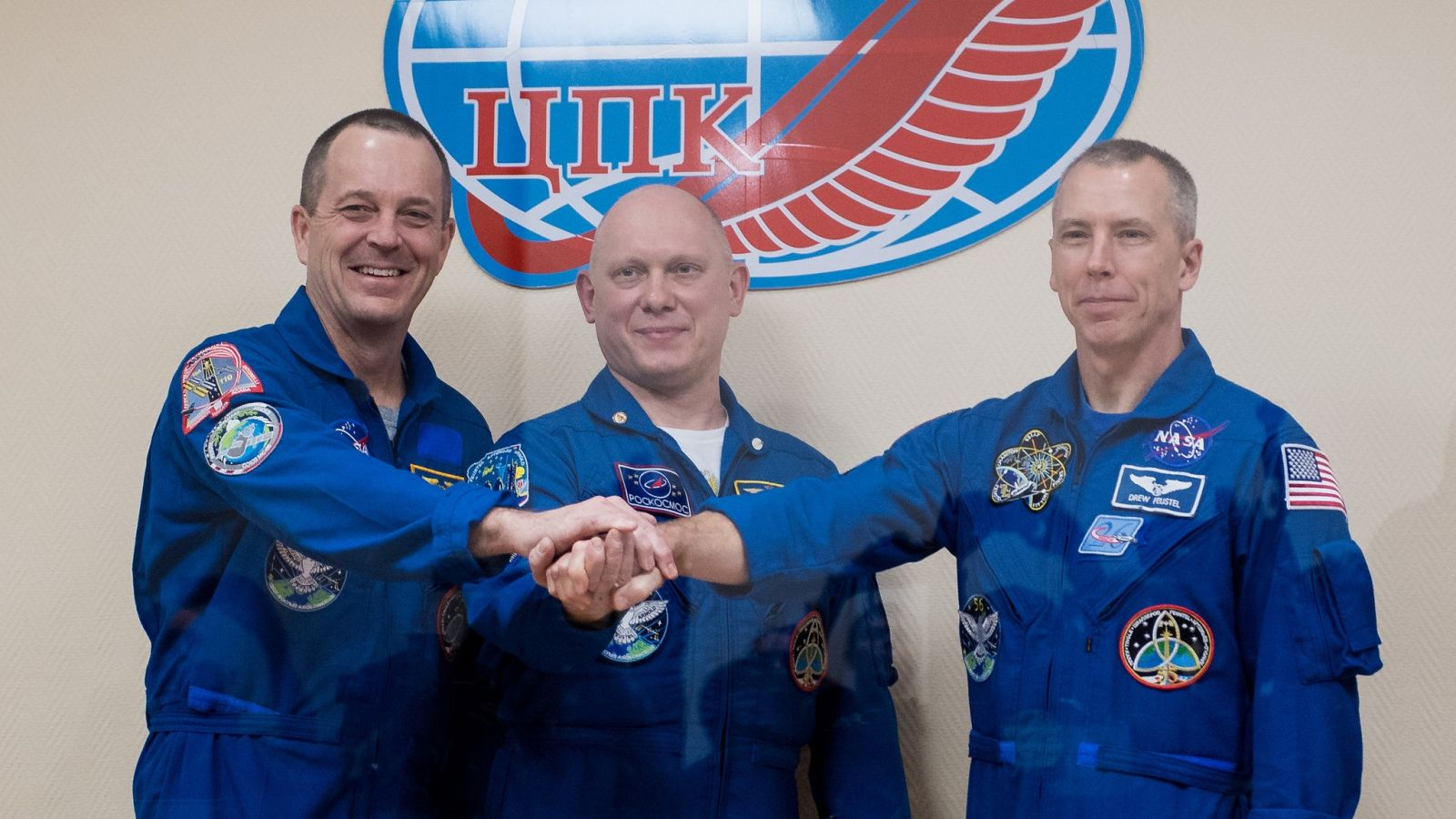 The Soyuz MS-08 crew poses for a picture. NASA's Ricky Arnold, left, Russia's Oleg Artemyev, center, and NASA's Drew Feustel are set to launch to the International Space Station on March 21, 2018. Photo Credit: Joel Kowsky / NASA