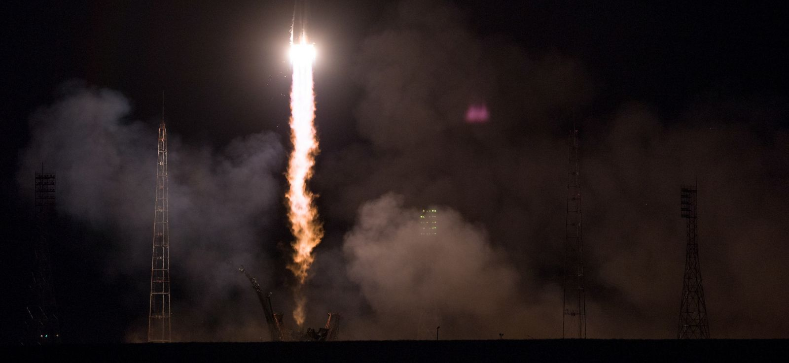 The crew of Soyuz MS-08 launches skyward to begin its trek to the International Space Station. Photo Credit: Joel Kowsky / NASA