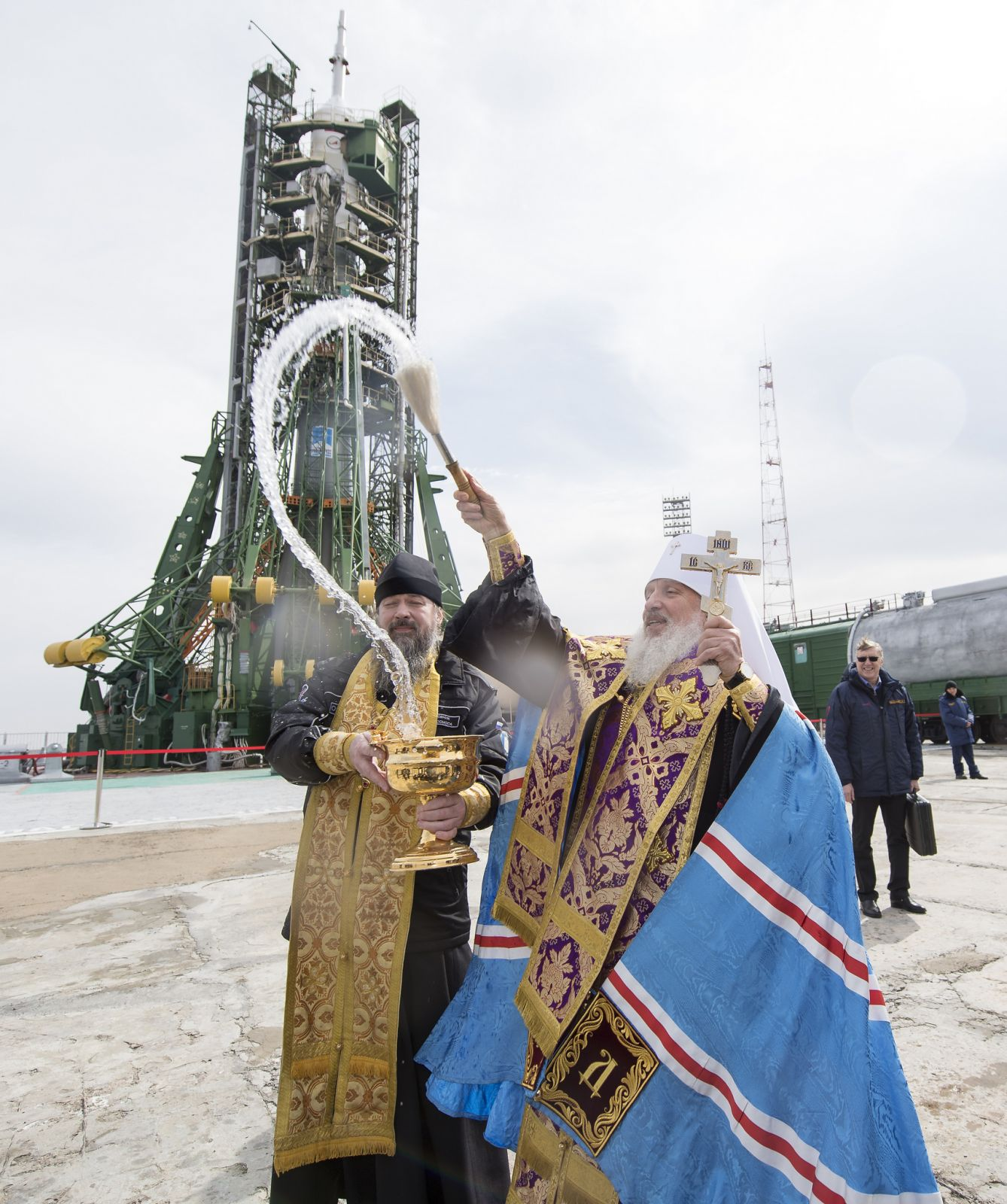 A Russian Orthodox Priest blesses the media at the launch pad. Photo Credit: Joel Kowsky / NASA