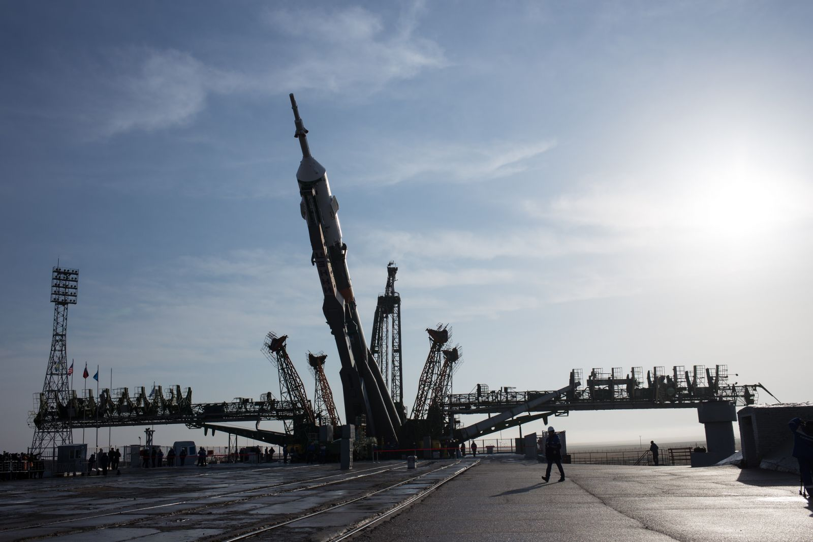 The Soyuz-FG rocket is lifted into the vertical position. Photo Credit: Joel Kowsky / NASA