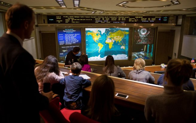 Friends and family watch Soyuz MS-08 dock on screens at the Russian Mission Control Center in Moscow. Photo Credit: Joel Kowsky / NASA