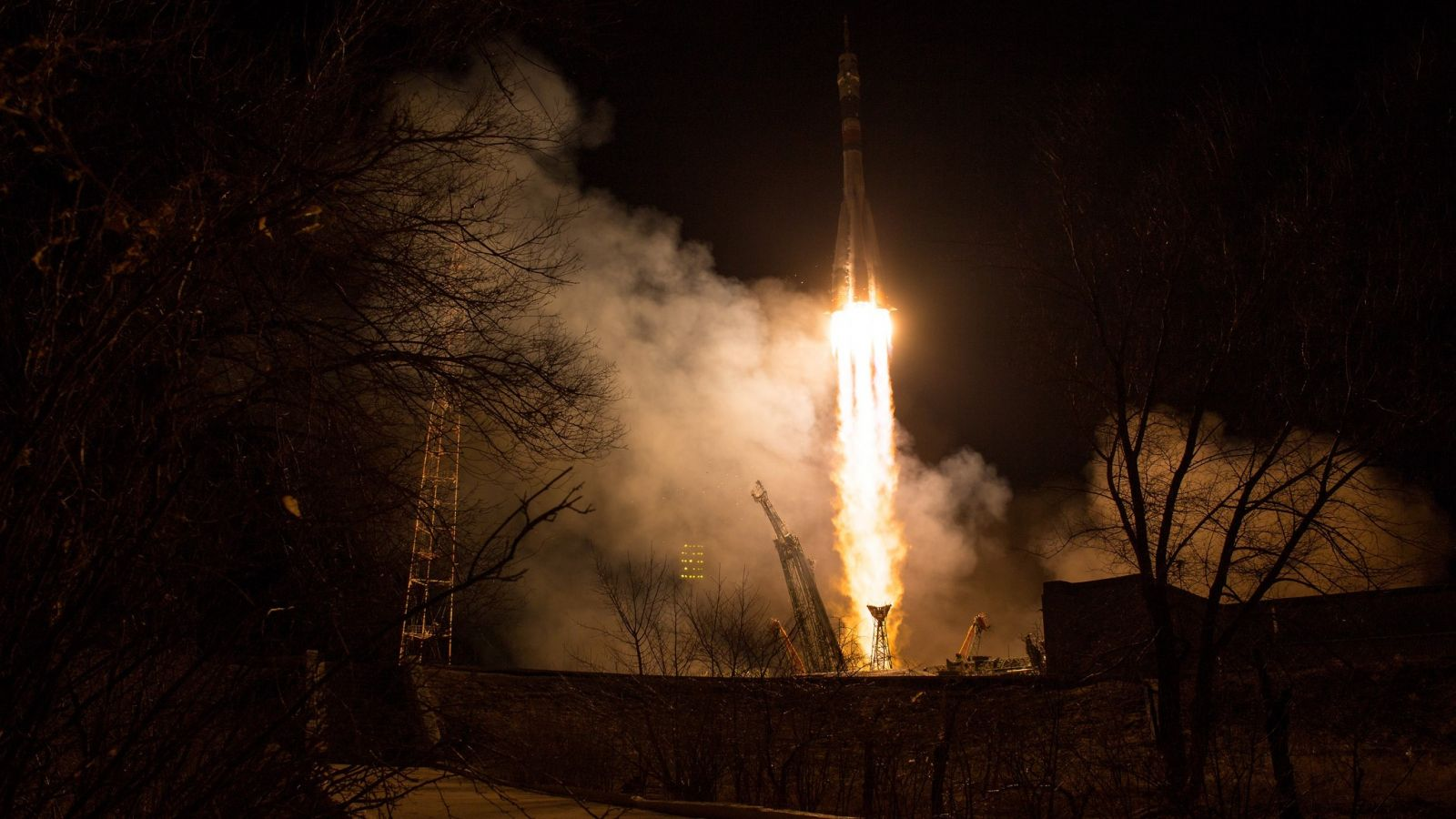 Soyuz MS-08 launches into the night sky. Photo Credit: Joel Kowsky / NASA
