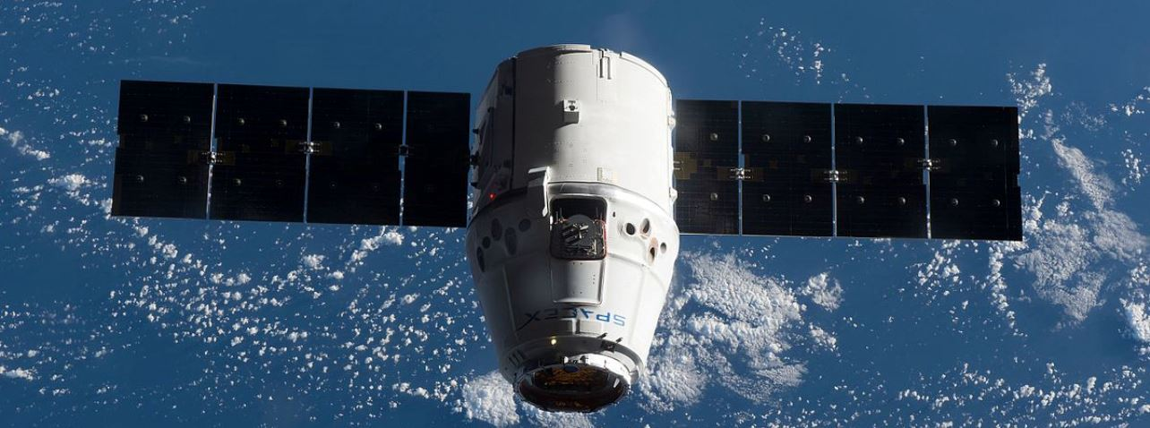 File photo of a previous Dragon spacecraft at the International Space Station. The next mission, CRS-14, will launch as early as April 2, 2018. Photo Credit: NASA