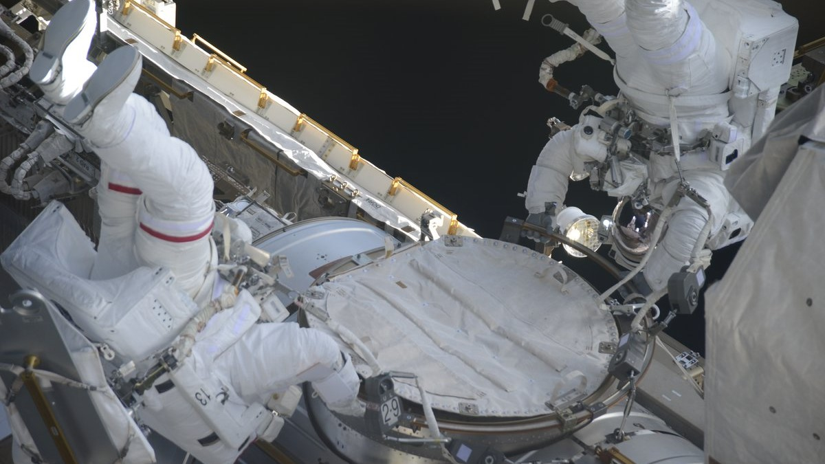NASA astronauts Drew Feustel and Ricky Arnold work outside the Quest airlock at the start of U.S. EVA-49. Photo Credit: Anton Shkaplerov / Roscosmos