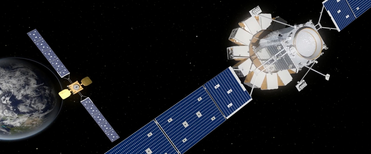 Artist's rendering of a MRV carrying MEPs (right) approaching a client satellite (left). Image Credit: Orbital ATK