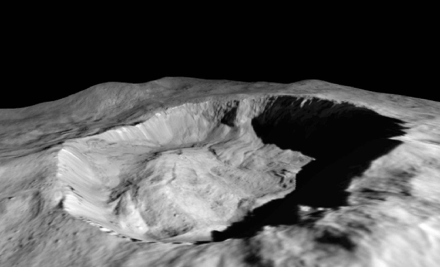 This view from NASA's Dawn mission shows where ice has been detected in the northern wall of Ceres' Juling Crater, which is in almost permanent shadow. Caption and Photo Credit: NASA / JPL-Caltech