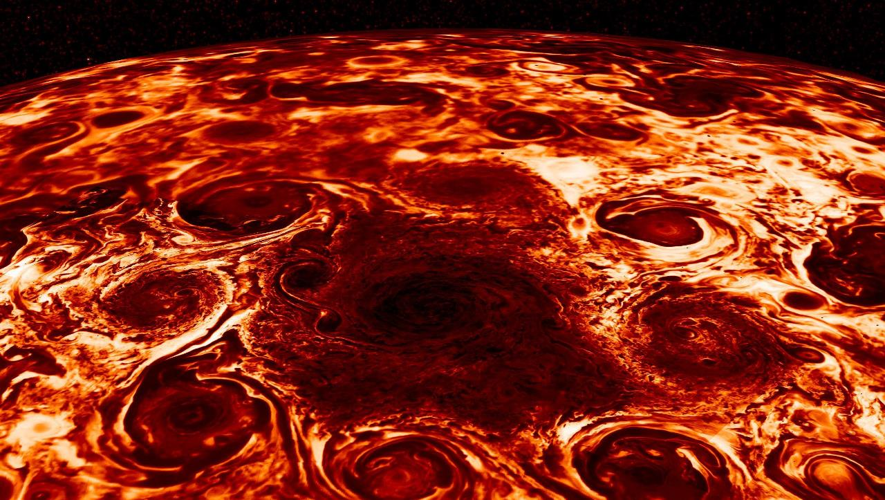 This composite image, derived from data collected by the Jovian Infrared Auroral Mapper or JIRAM instrument aboard NASA's Juno mission to Jupiter, shows the central cyclone at the planet's north pole and the eight cyclones that encircle it. Image Credit: NASA/JPL-Caltech/SwRI/ASI/INAF/JIRAM