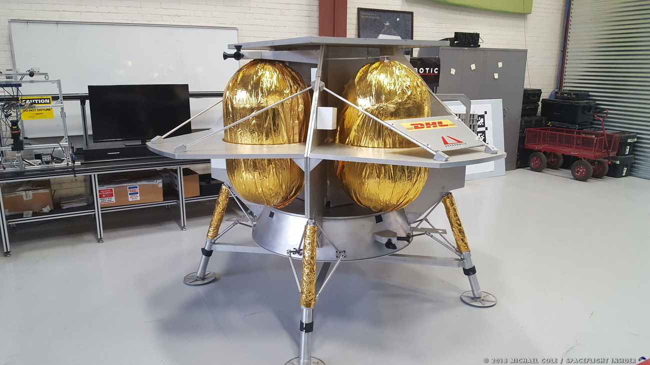 The Astrobotic pilgrim landing module in the company's laboratory in Pittsburgh, Pennsylvania. Peregrine's first mission is scheduled to deliver a collection of rovers, scientific instruments and personal memories to the surface of the Moon sometime in 2020. Photo credit: Michael Cole / Spaceflight Insider