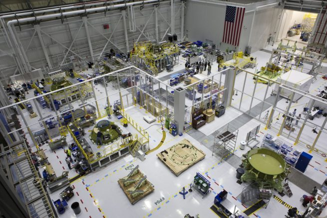 A view from above in Boeing's Commercial Crew and Cargo Processing Facility at NASA's Kennedy Space Center in Florida. This photo, taken in October 2017, shows multiple Starliner spacecraft in various stages of production. Photo Credit: Kim Shiflett / NASA