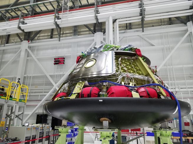 On March 15, 2018, Boeing engineers installed the base heat shield for Starliner Spacecraft 1 at the company's Commercial Crew and Cargo Processing Facility in Florida. This vehicle will be used for a pad abort test at White Sands Missile Range in New Mexico sometime in the first half of 2019. Photo Credit: Boeing