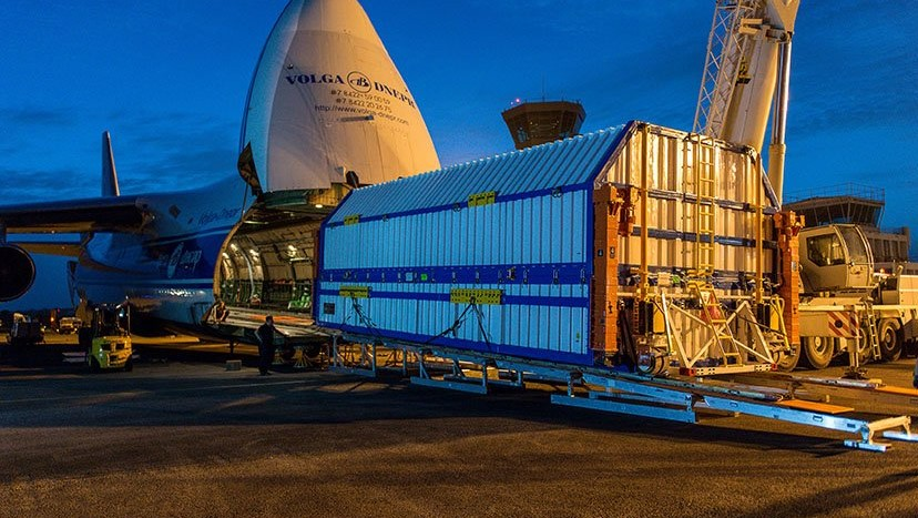 "The GSAT-11 spacecraft is unloaded upon arrival in South America on March 28, 2018. Now the satellite is being shipped back to India for ""technical checks."" Photo Credit: Arianespace"