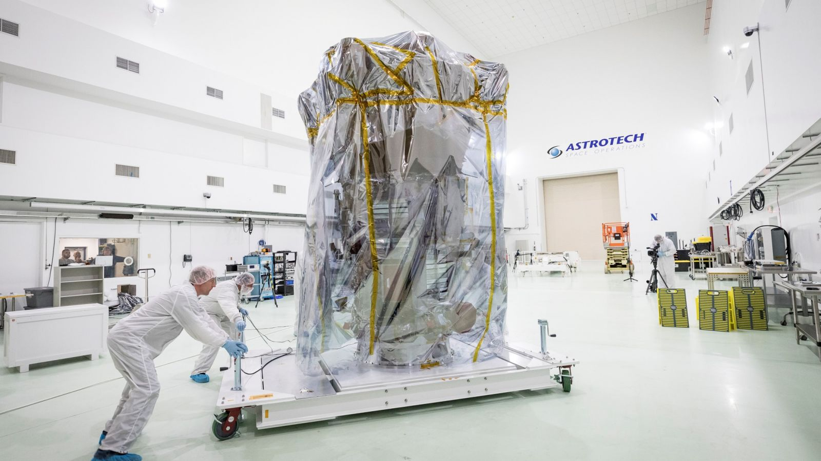 The Parker Solar Probe is moved into Astrotech Space Operation's clean room in Titusville, Florida, to begin final preparations before launch. Photo Credit: Ed Whitman / Johns Hopkins APL / NASA