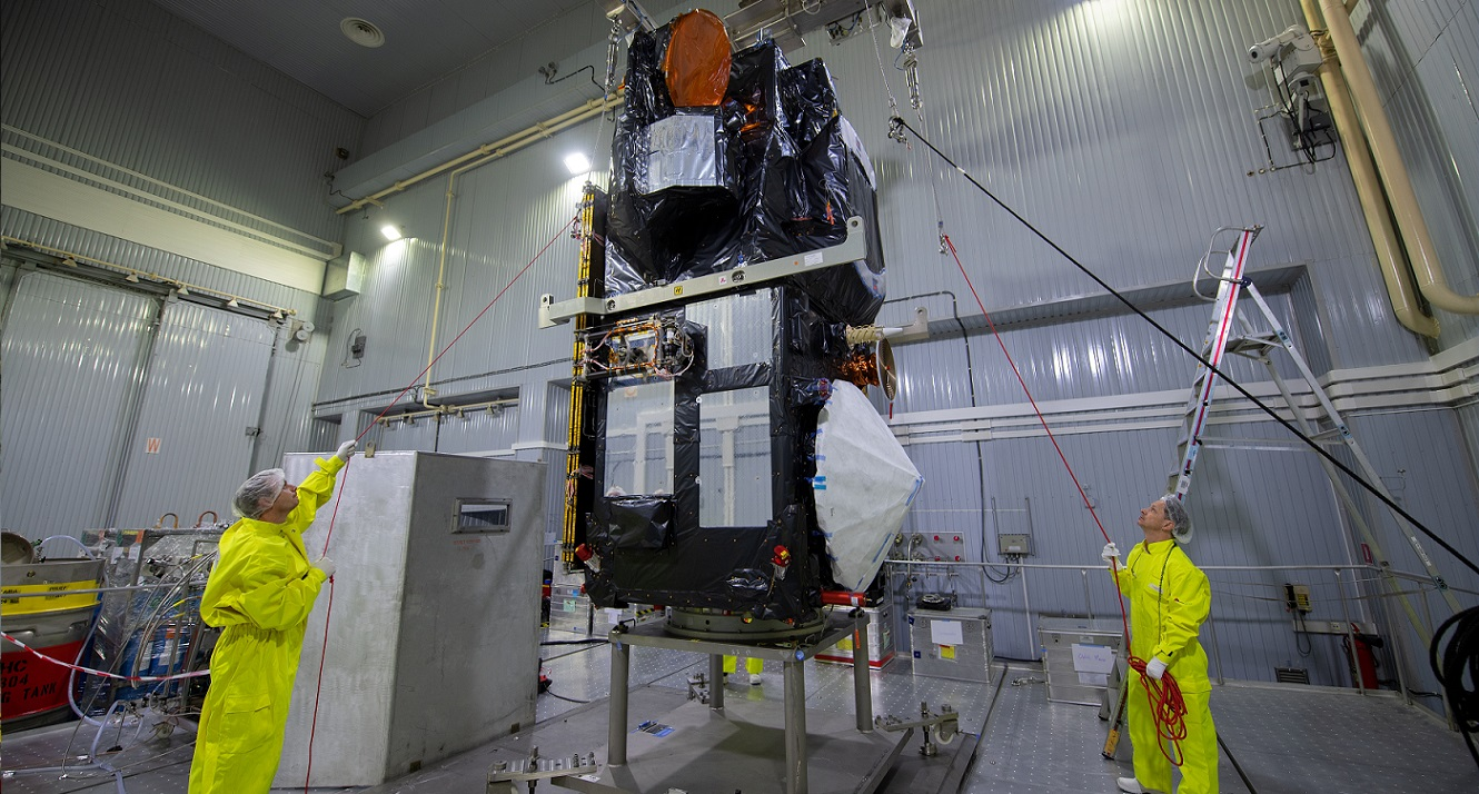 Engineers connect the Sentinel 3B spacecraft to the Rokot payload adapter. Photo Credit: S. Corvaja / ESA