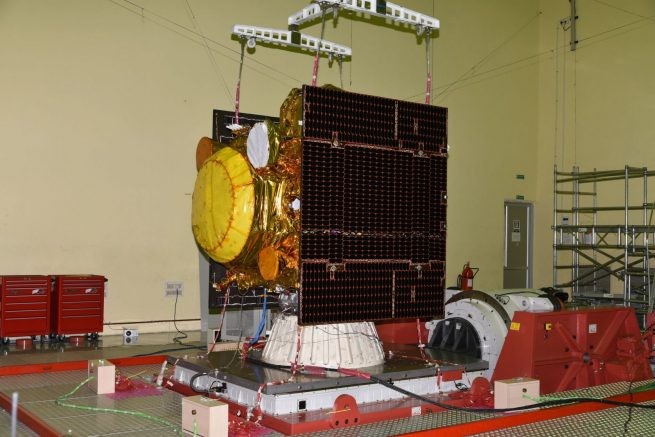 IRNSS-1I undergoes a vibration test. The satellite will be a replacement for the IRNSS-1A spacecraft launched in 2013. Photo Credit: ISRO