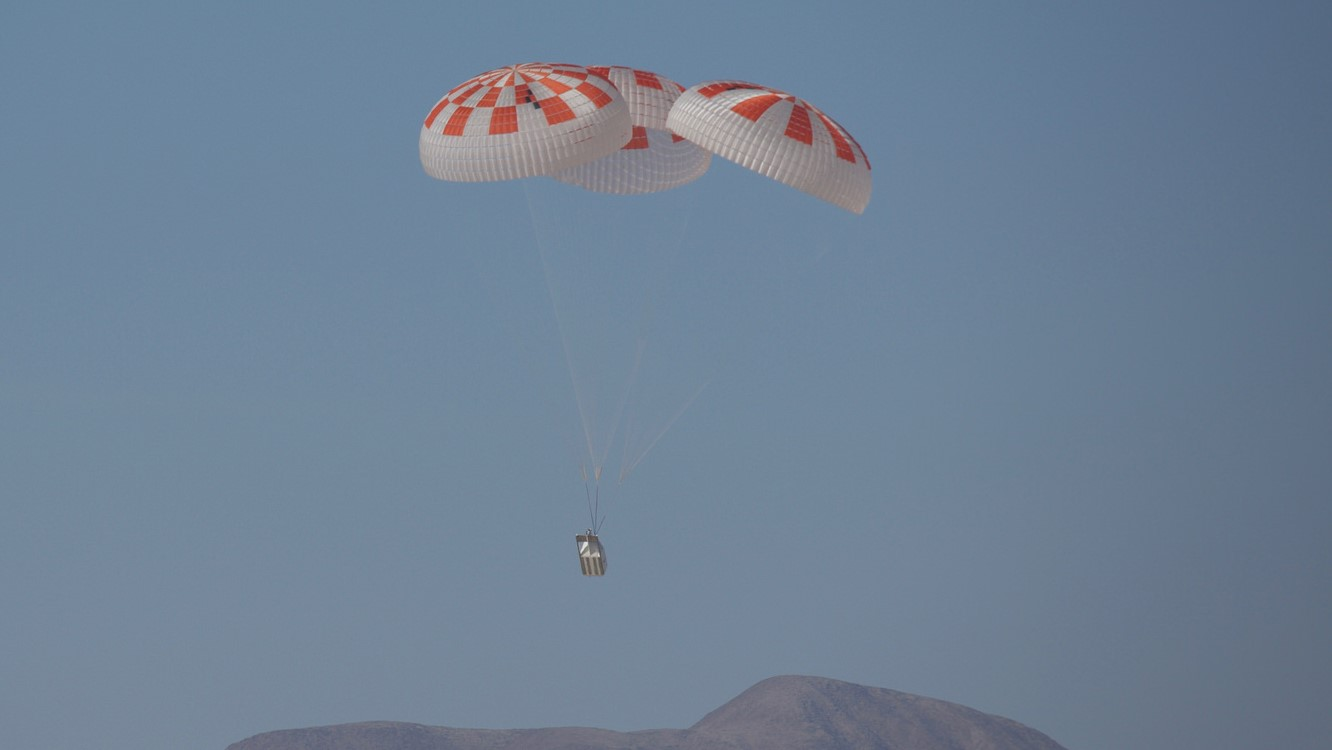 SpaceX performs a drop test of its Crew Dragon parachutes. This scenario evaluated an off-nominal situation, deploying only one of the two drogue chutes and intentionally skipping a deployment stage on one of the four main parachutes, according to NASA. Photo Credit: SpaceX