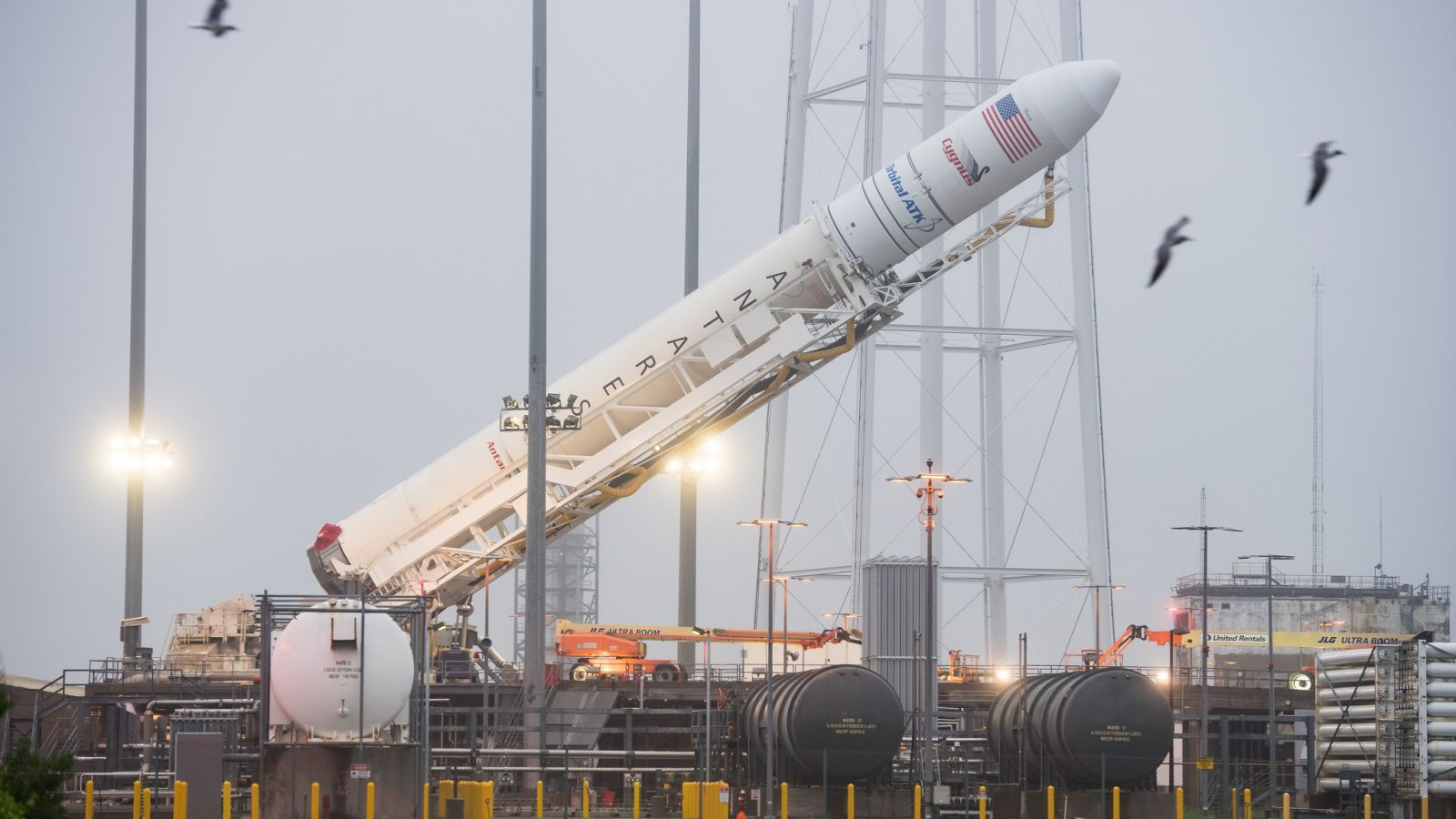 Orbital ATK's Antares rocket with the OA-9 Cygnus encapsulated on top is raised to the vertical position in advance of its launch. Photo Credit: Aubrey Gemignani / NASA