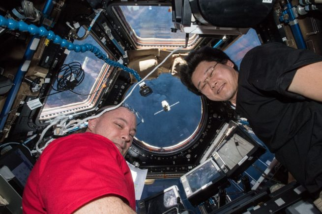 NASA astronaut Scott Tingle and Japan Aerospace Exploration Agency astronaut Norishige Kanai monitor Dragon as it rendezvoused with the outpost in early April 2018. Photo Credit: NASA