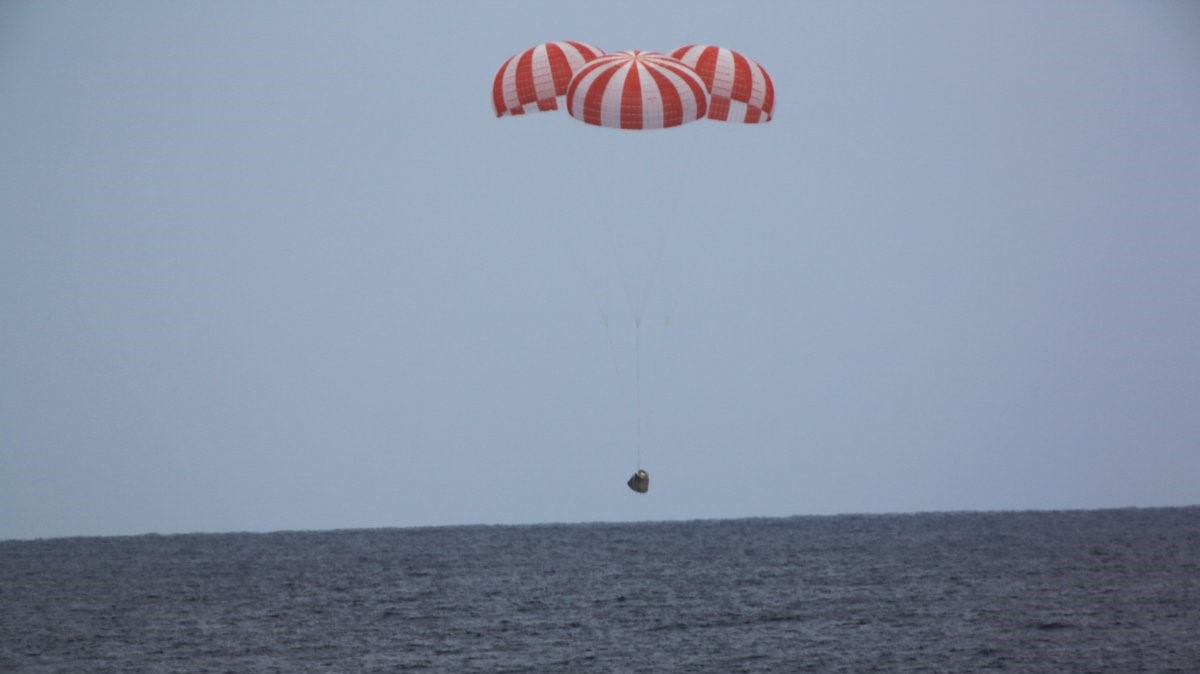 A file photo of a previous Dragon splashing down in the Pacific Ocean. Photo Credit: SpaceX