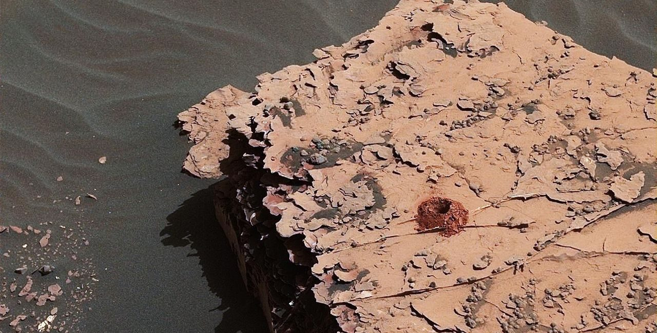 "NASA's Curiosity rover successfully drilled a 2-inch-deep hole in a target called ""Duluth"" on May 20. It was the first rock sample captured by the drill since October 2016. This image was taken by Curiosity's Mast Camera (Mastcam) on Sol 2057. Image Credit: NASA/JPL-Caltech/MSSS"