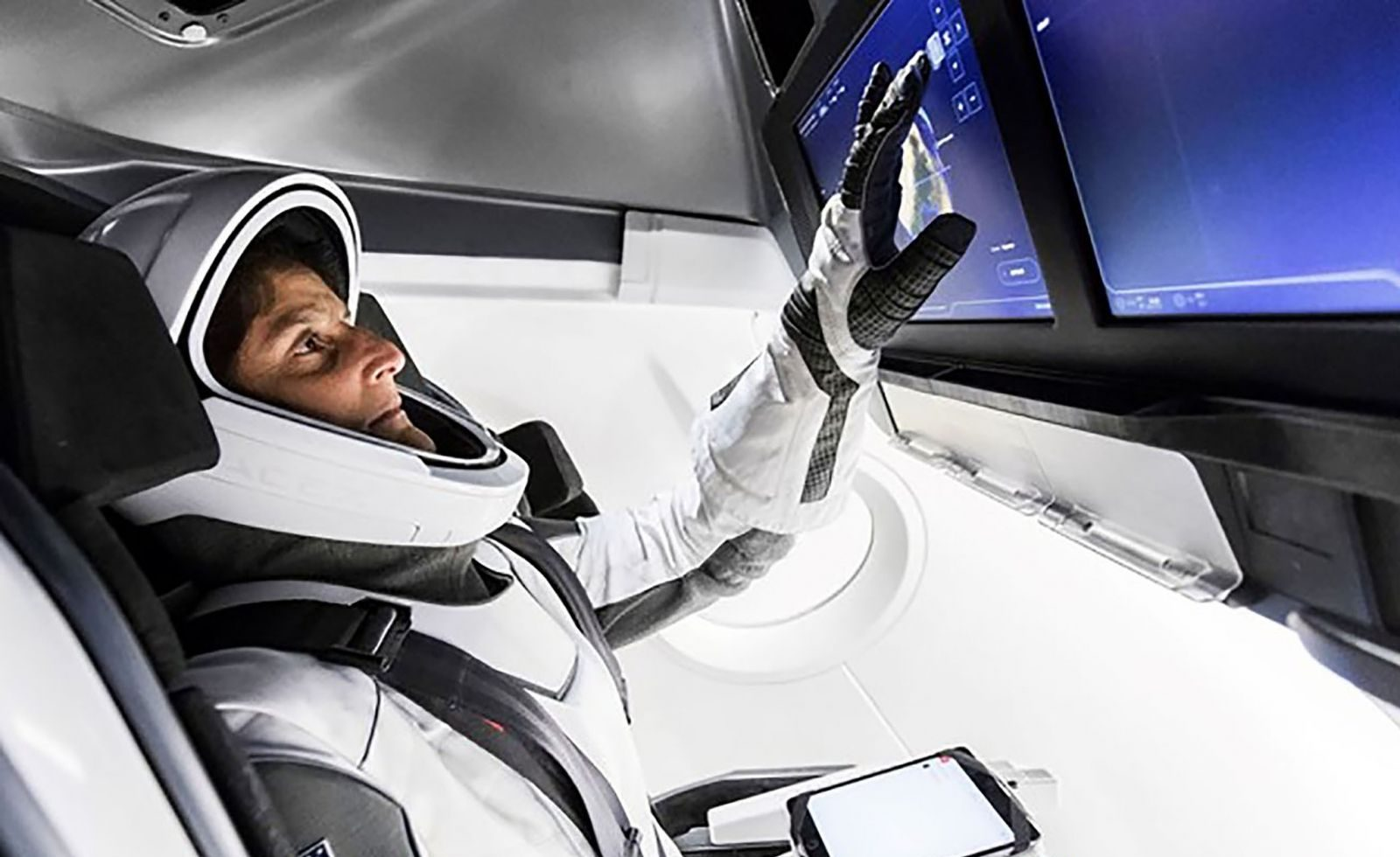 NASA astronaut Suni Williams takes part in a simulated mission aboard SpaceX's Crew Dragon spacecraft. Williams is wearing SpaceX's spacesuit design. Photo credit: SpaceX